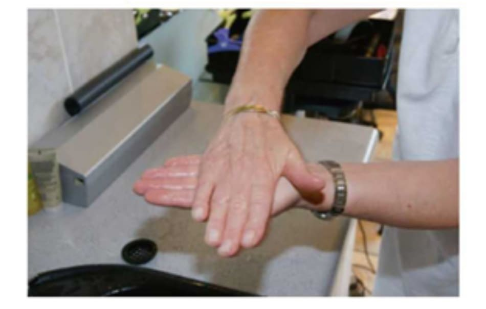 Fig. 7.22 Spread the shampoo evenly across both hands